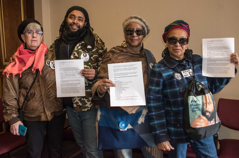 Philadelphia, Feb 6 - A letter to Philly DA Larry Krasner was delivered to his office on Feb 6 by L to R) Cindy Miller, Wayne Cook (Mumia Abu-Jamal's nephew), Linda Ragin, Pam Africa and Joe Piette (behind camera)