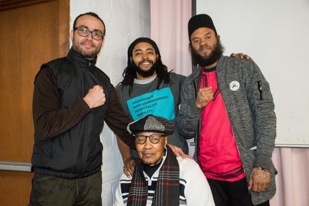 Feb 23, Darby, PA - (L to R) Robert Saleem Holbrook, Keith Cook, Wayne Cook, Wali Akbar El pose after speaking on a panel at Mumia Day (Darby Community Black History Month Program)