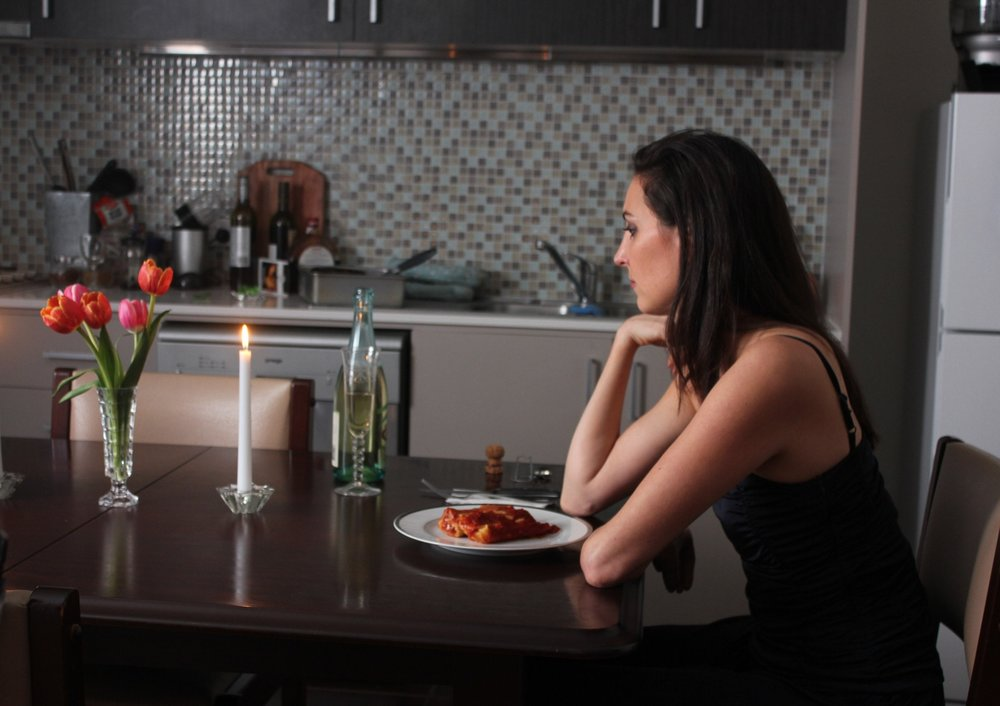 Aurora preparesfor a special anniversary dinner - She goes about her day, alone, reminiscing about her lover, but a truth hangs over her like a dark cloud.