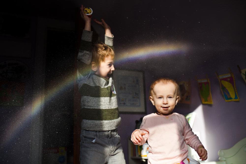 happy-children-catching-a-rainbow-in-bedroom.jpg
