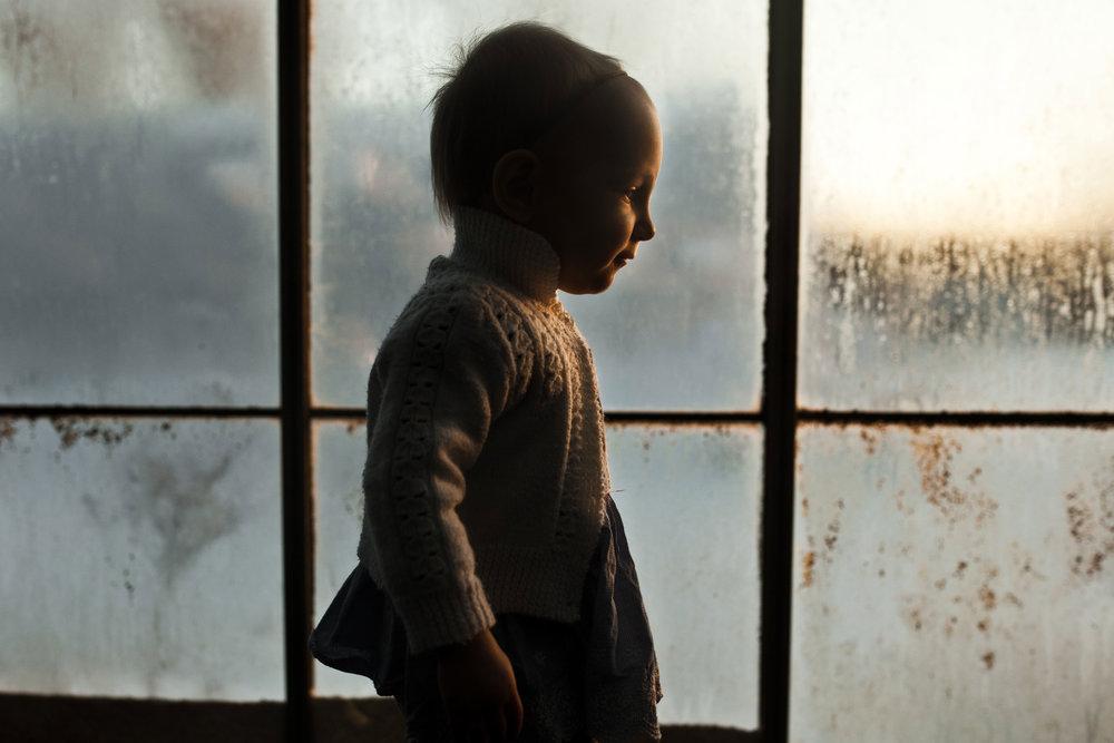 toddler-girl-greenhouse-moody-light-hamilton-photographer.jpg