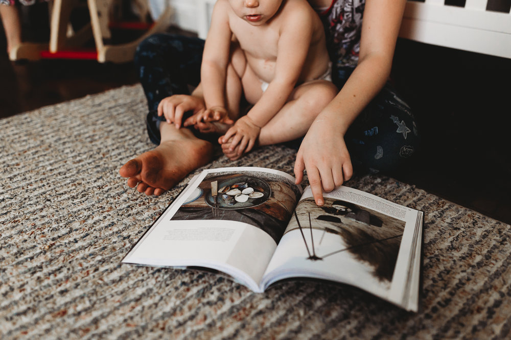 This one just melts my heart because of the connection. I love it when big sis takes an active part in the little ones' lives and sits down for one on one time. Here, Lauren was showing pictures to our little Eleanor... she was very interested, it was so cute! I am also a sucker for creative crops and detail captures!