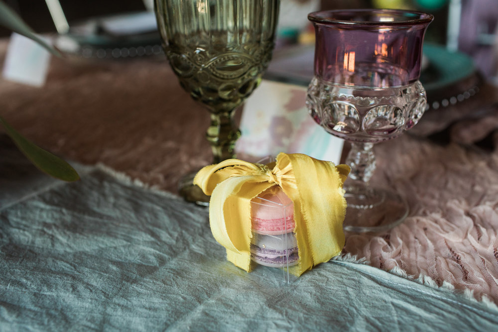 ribbon and table runner by Rosemarine Textiles, macaroons by  Belle e Dolce , place cards by  Jade Social , rentals by  Special Occasions East