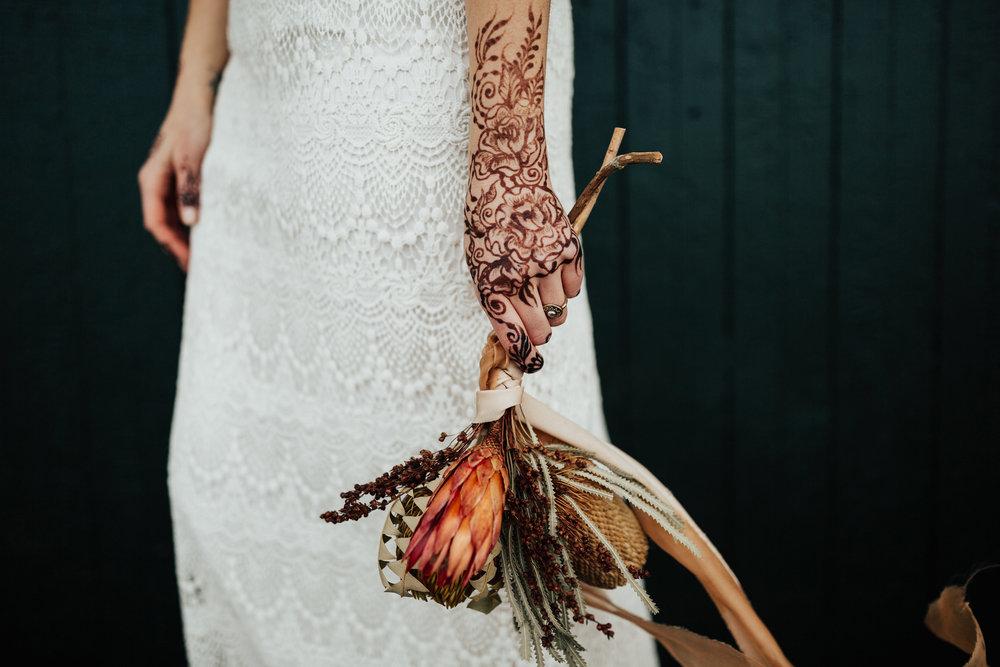 henna by Kelly Caroline, ribbon by Rosemarine Textiles, bouquet by Birch Affair, jewelry by Courtney Fischer, photo by Tana Helene