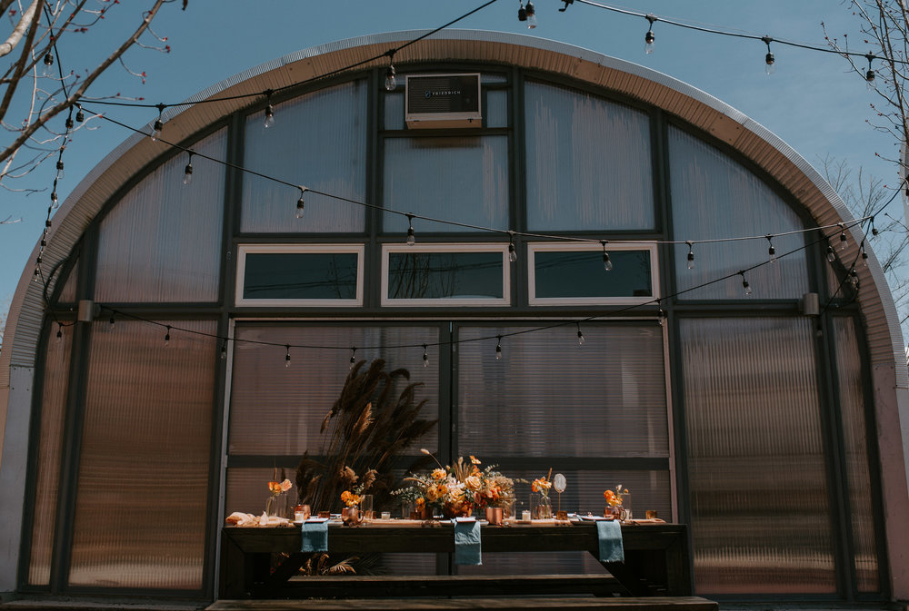 The quonset hut with a backyard farm table dining setup. All photos by    Northern Native Photography.