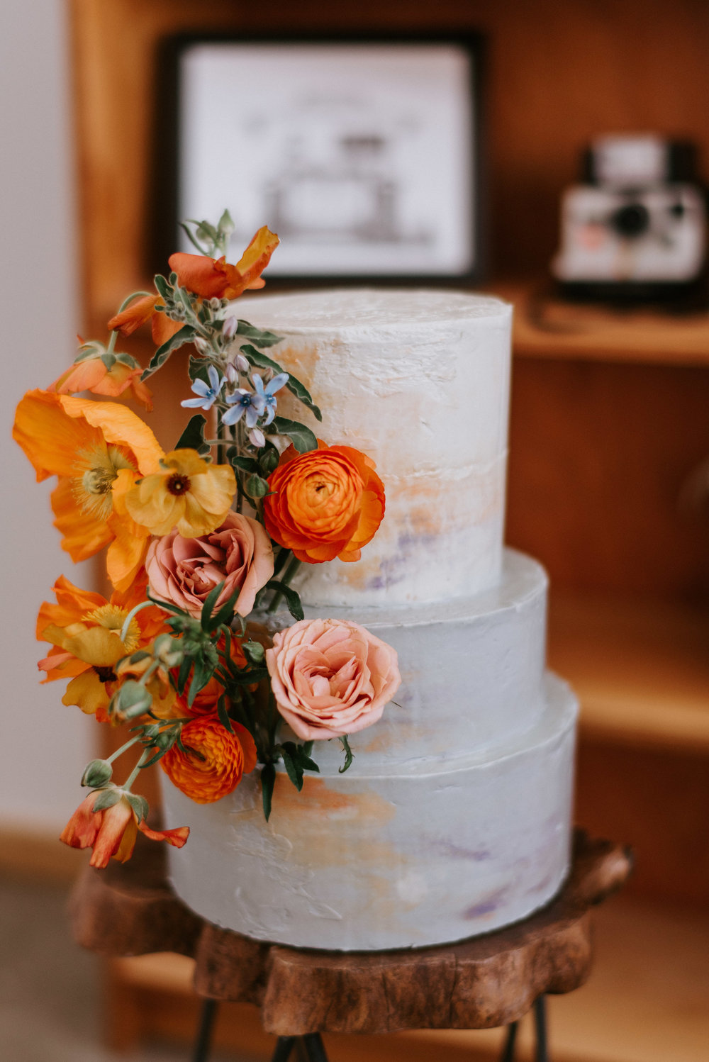 A bright and elegant 3 tiered cake by Amalia Bakery Detroit.
