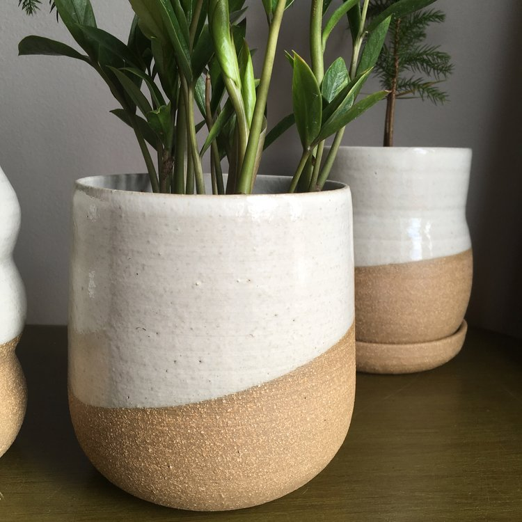 held ceramics  - Held creates a variety of wares for your home. Whether it's a planter for your growing houseplant collection, a new favorite mug, or a lamp to illuminate your living room, held has something for you.
