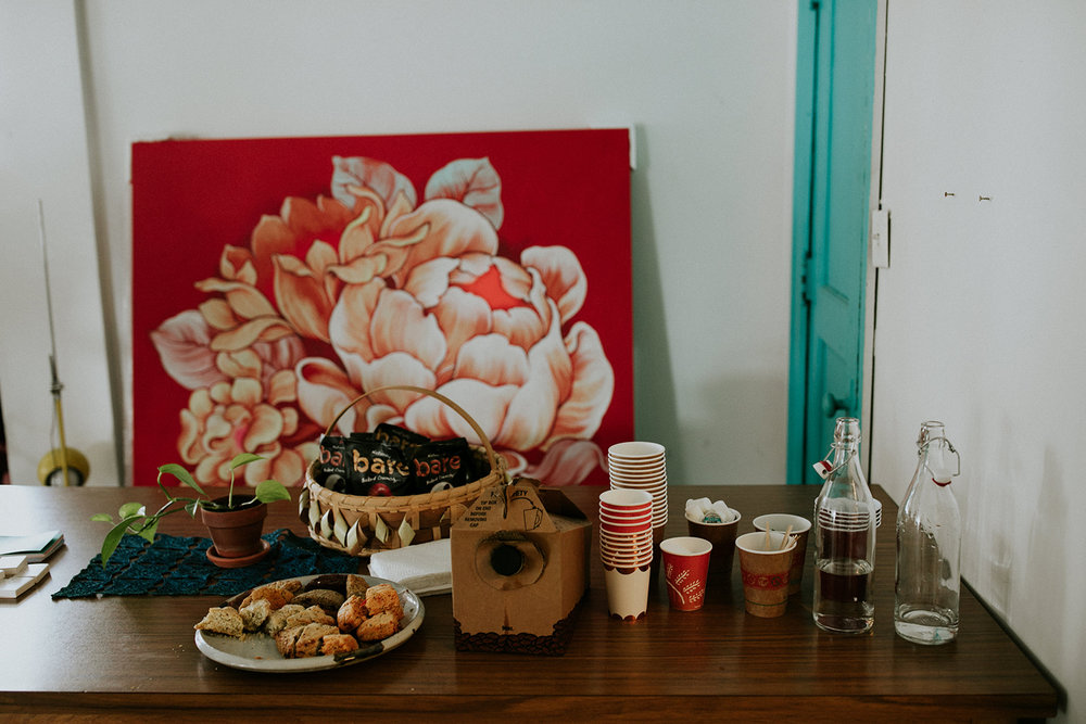 Snacks & Coffee from  Bare  and  Avalon Bakery . Five Palms Detroit Studio artist  0uizi's  painting in the background.