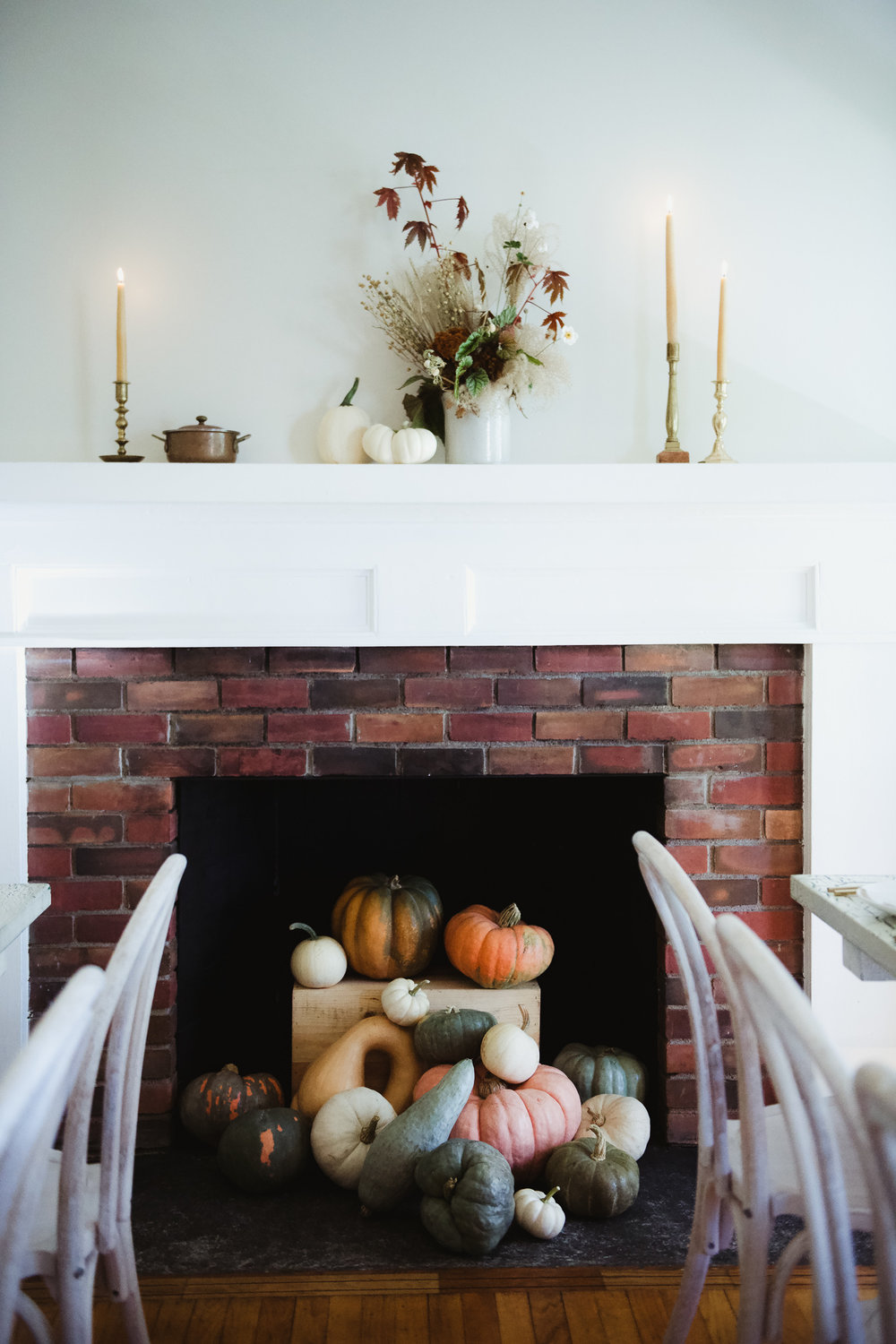 Loden Floral  utilized locally sourced heirloom pumpkins and gourds as festive decor in the farmhouse fireplace.