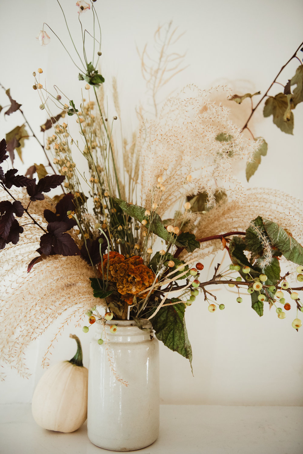 Loden Floral  autumnal arrangements including locally grown casper pumpkins