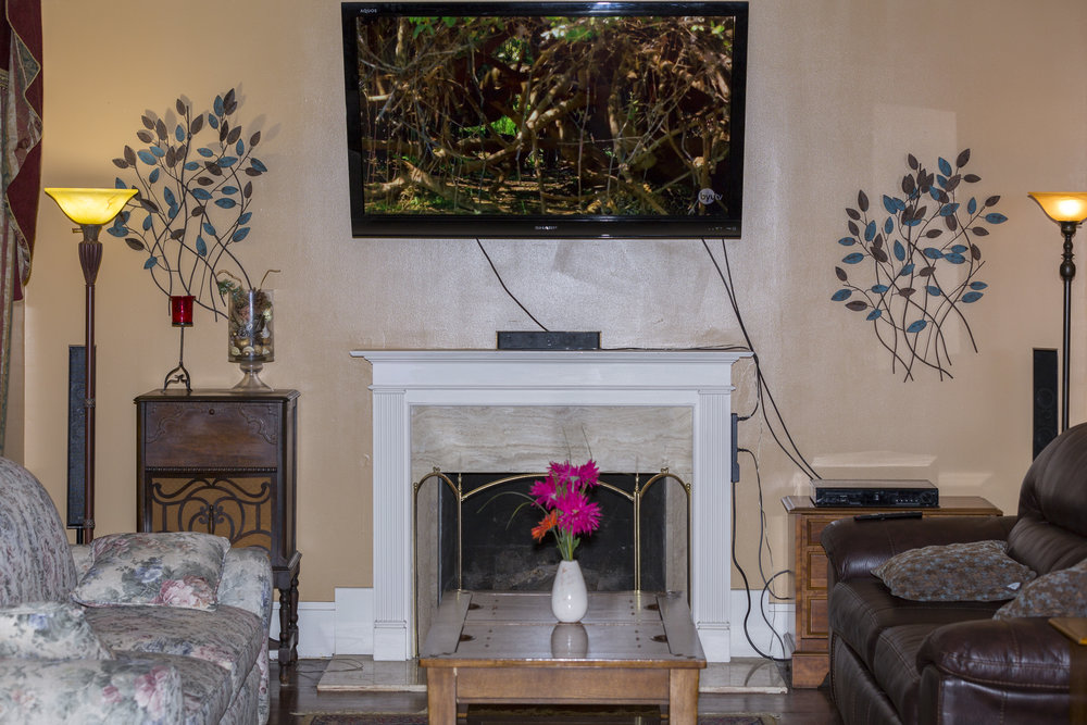 13. Parlor fireplace _ 60_ TV .jpg