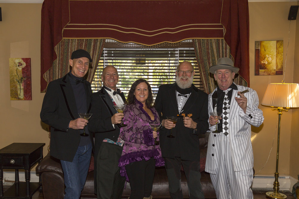 34. Period costume clad Characters toast to the roaring 20_s.jpg