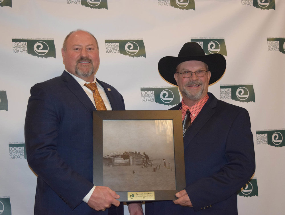 Representative Kevin Wallace of Lincoln County received the OACD Legislator of the Year Award from president Jimmy Emmons.