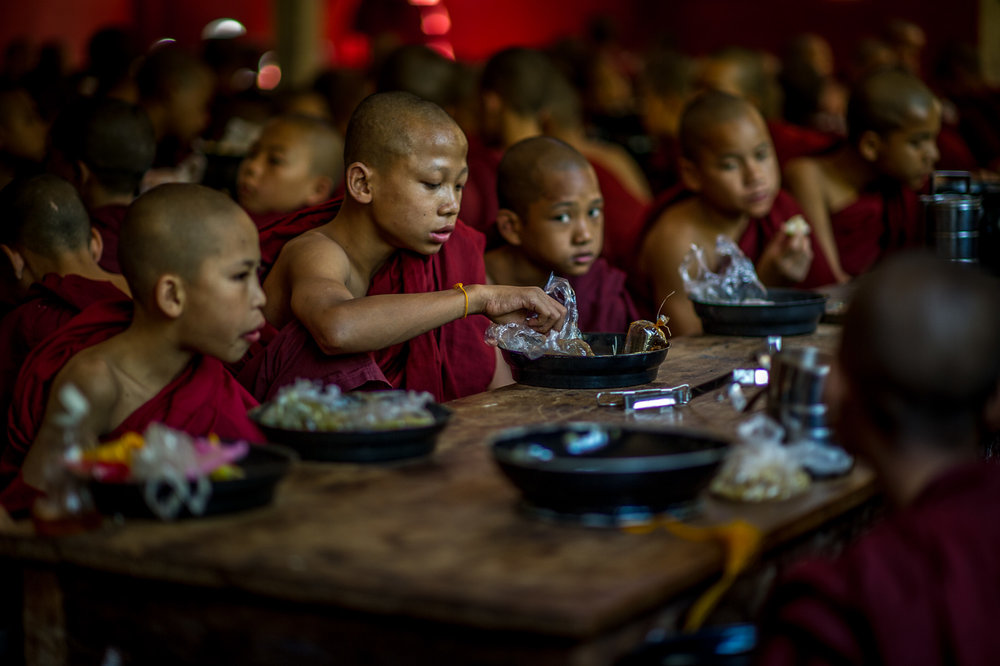 Young monks during lunch time. Bagan, Myanmar.
