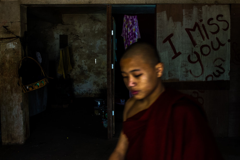 Young monk leaving his room in the monastery. Bagan, Myanmar.