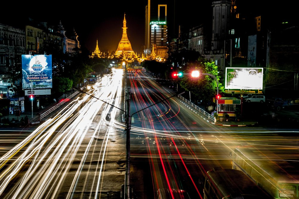 Traffic at night in front of golden Sule Pagoda. Yangon, Myanmar.