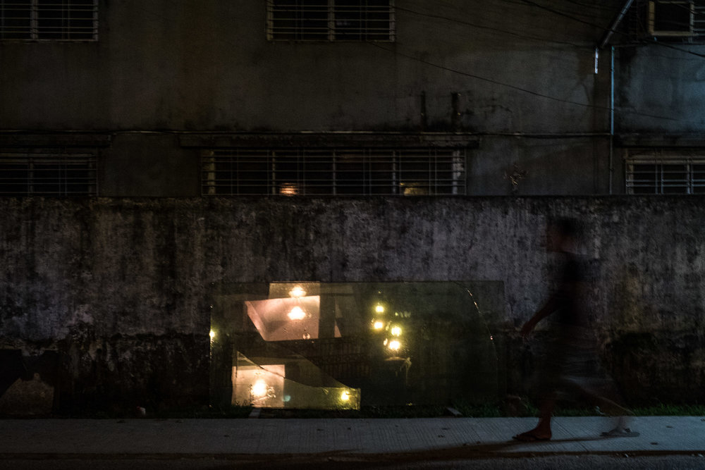 Man walking at night. Yangon, Myanmar.