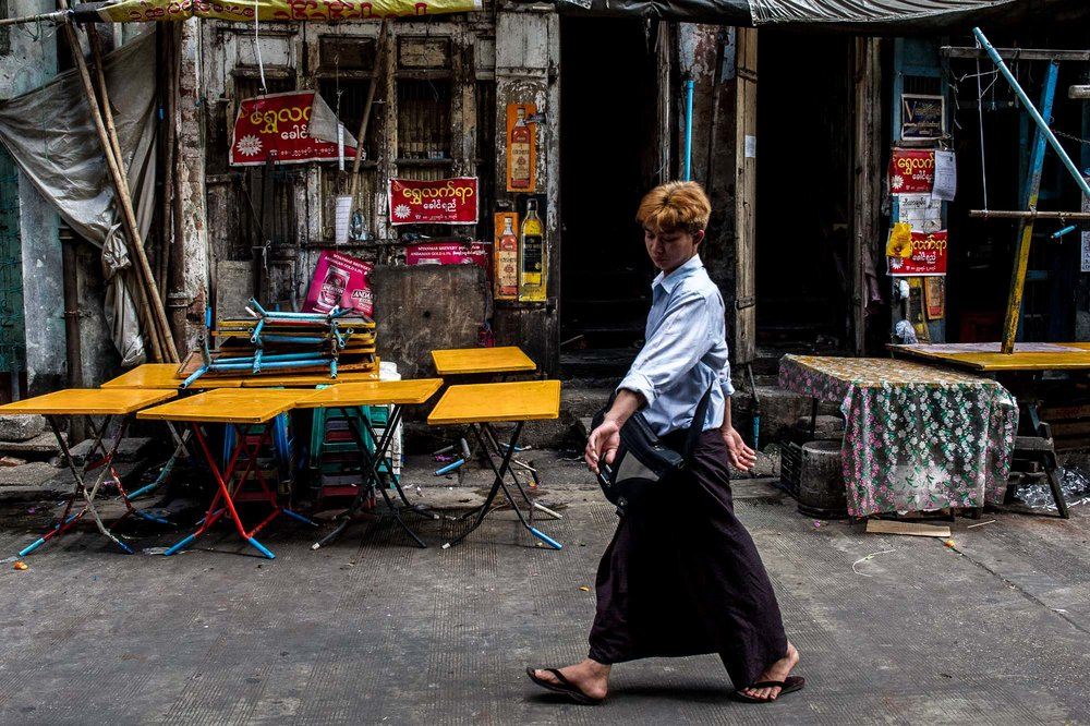Young man strolling on the street. Yangon, Myanmar.