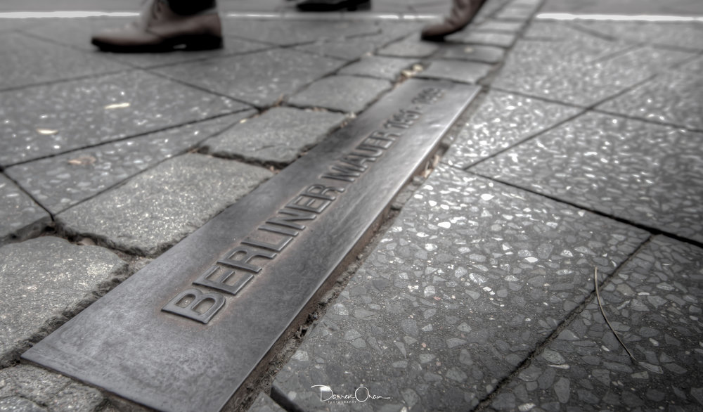 Line of bricks marking the former route of the Berlin Wall