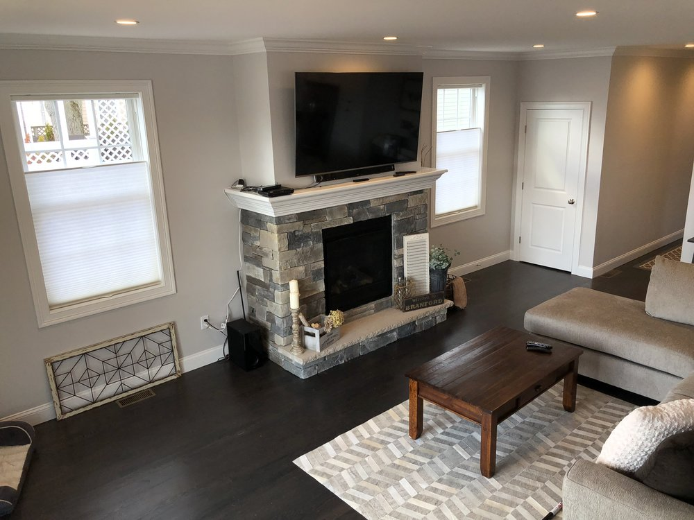 These top-down bottom-up light filtering cellular shades bring just the right amount of privacy to this gorgeous living room in branford center. these blinds are functional in so many ways including insulating, light control, privacy & security, yet are compact and low profile when lifted to the top of the casing.