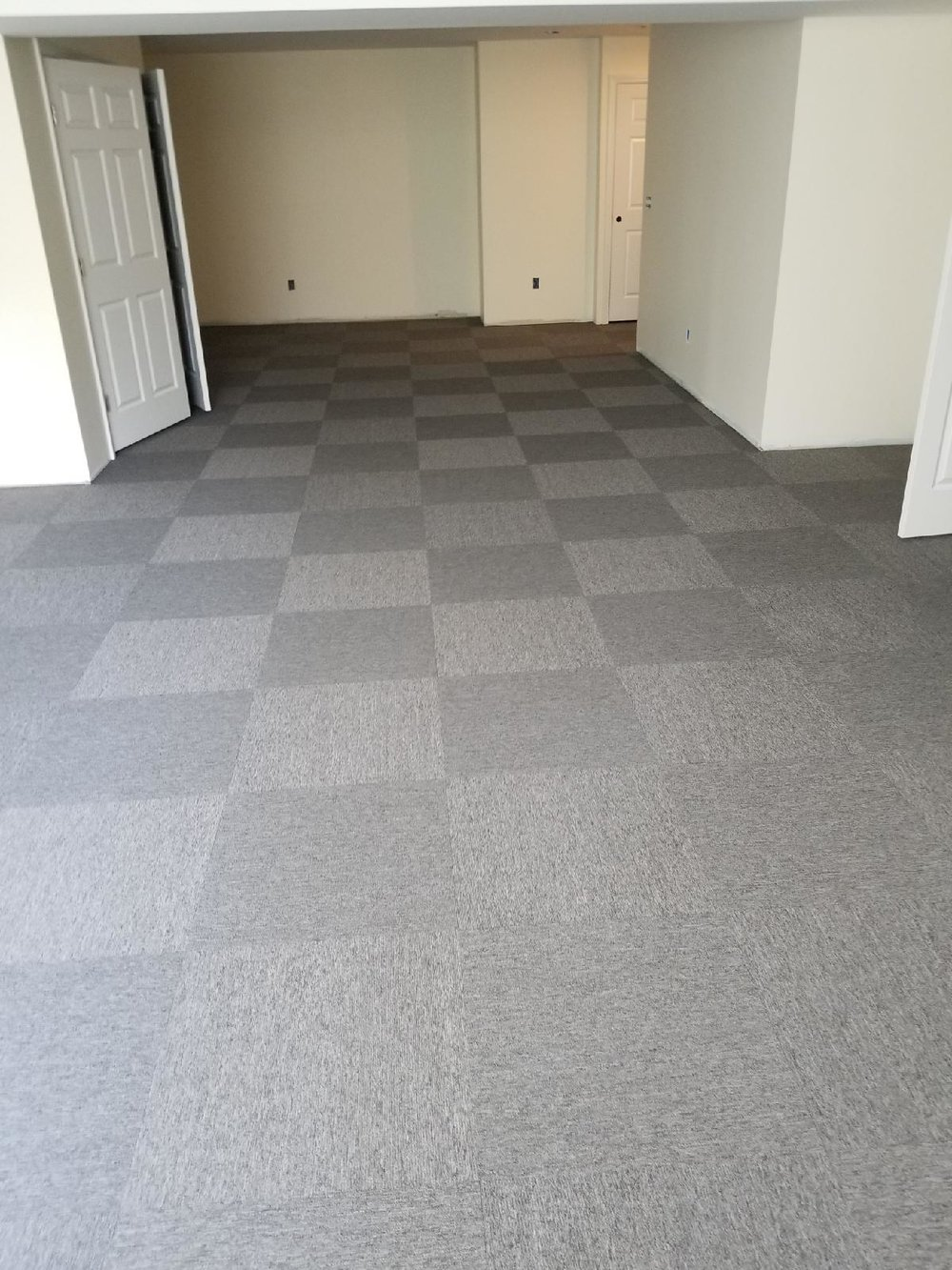 these 2' x 2' carpet tiles were recently installed for a customer in wallingford, ct. carpet tiles offer the utmost DURABILITY and were installed with a fun quarter-turn rotation giving it a great checkered pattern.