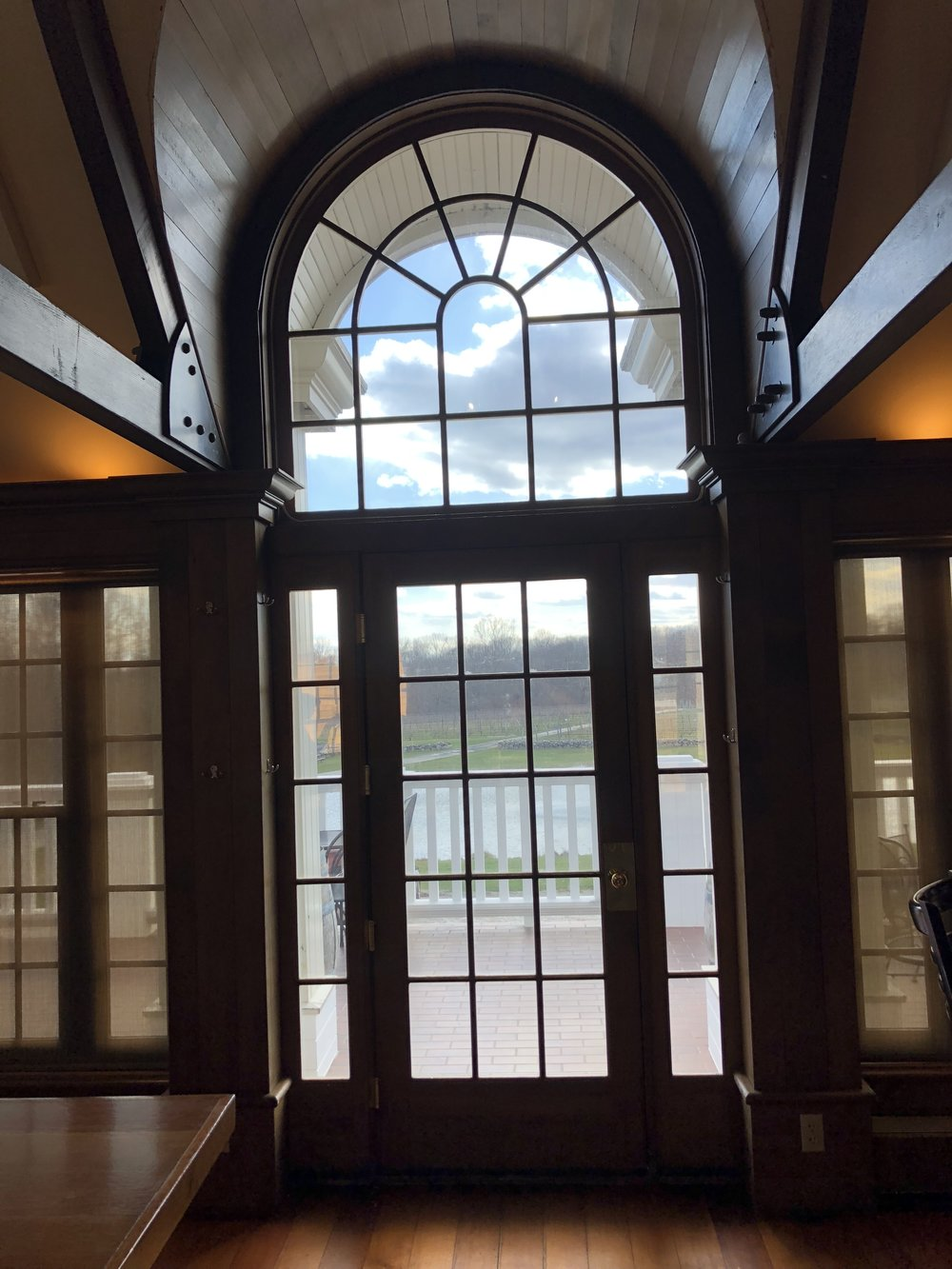 although possible- speciality window treatments aren't always financially practical- here in clinton, ct we installed solar window film that eliminated harsh uv rays which turned this room into a greenhouse, without COMPROMISING this priceless view of the vineyards.