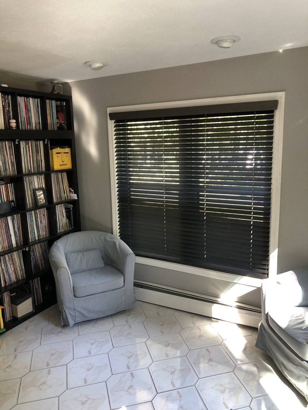 THESE WIRE-BRUSHED 2 INCH WOOD BLINDS ARE A BOLD STATEMENT IN THIS CONTEMPORARY SPACE IN CLINTON, CT. THE 'JAVA' COLOR ADDS THE PERFECT CONTRAST TO COMPLEMENT THE REST OF THE PIECES IN THROUGHOUT THE ENTIRE HOME!