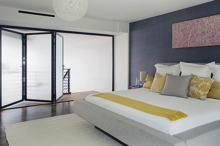 accent-wall-bedroom-black-frame-folding-doors