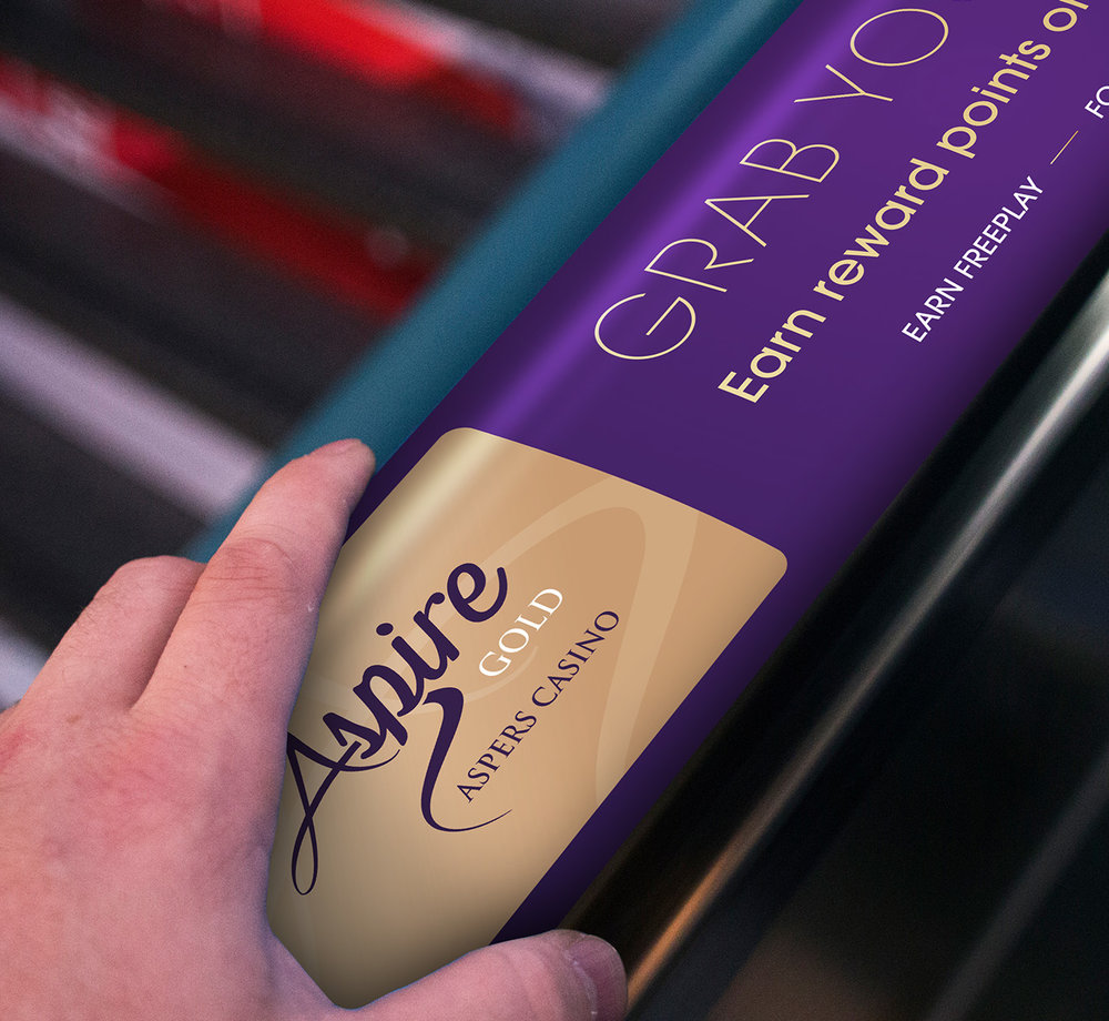 - As you enter Aspers casino the first POS is an escalator leading to the entrance. I introduced a concept of placing a POS design on the handrail of the escalators showcasing the new Aspire card.This idea literally places the card in the hands of the consumer even before they enter the casino.