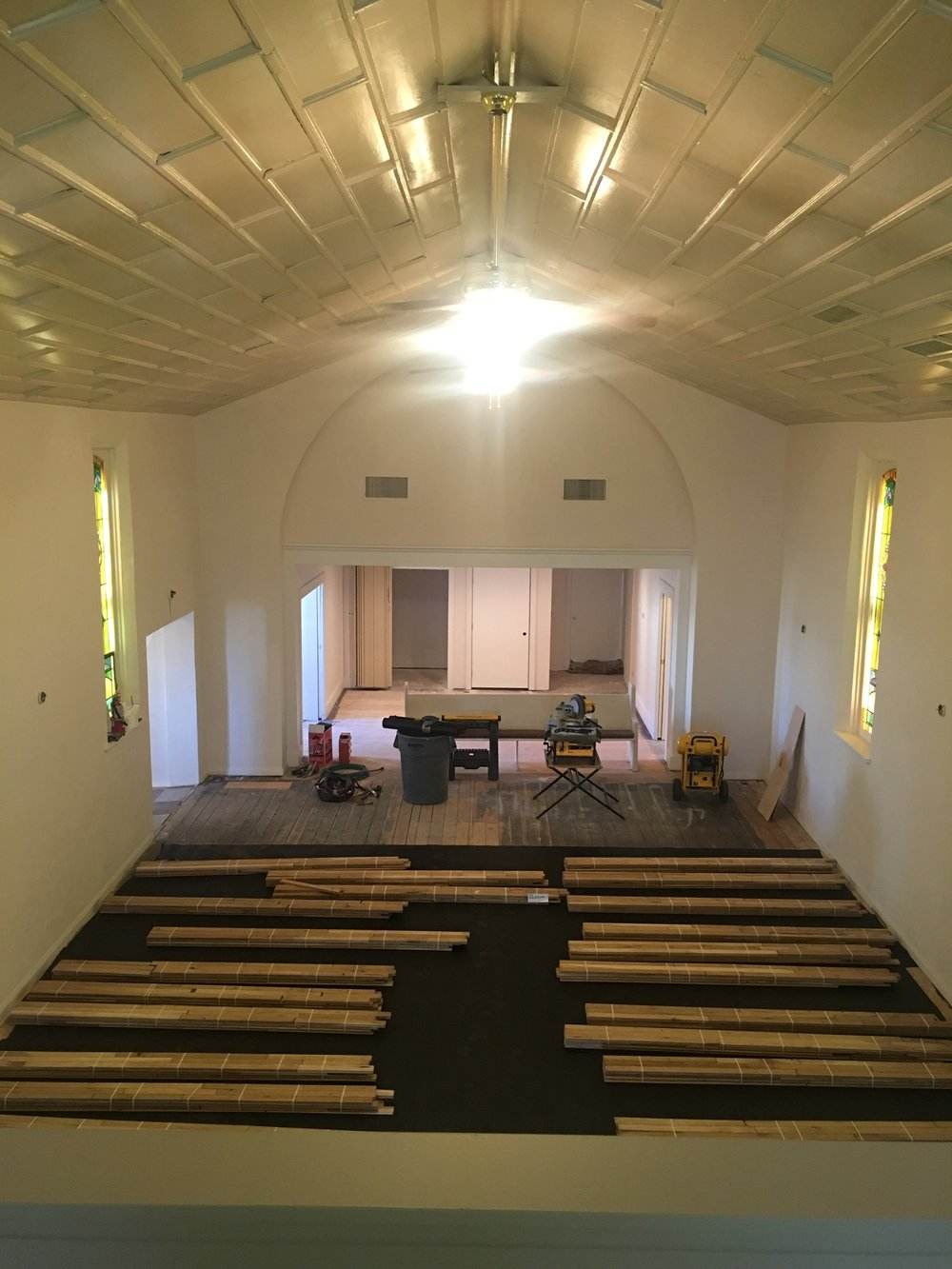 Alli Event Center, Brighton Co sanctuary hardwood floor installation.