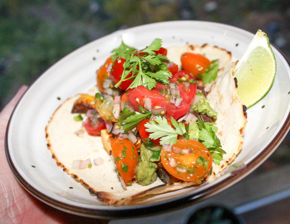 Squash Taco with garden kale, black beans, pico, & guacamole