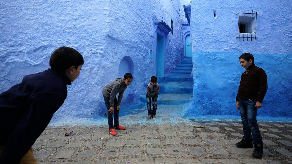 Children play in the blue Moroccan town of Chefchaouen.