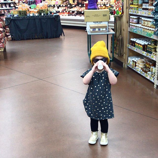 Just a toddler of a basic Millennial. Taste testing kombucha at Trader Joe's. I'm so grateful this little nugget is being raised to love real food. Don't get me wrong she will still snag a donut if it's in reach... 🍩⠀ •••⠀ But her normal is real, whole food that's nutrition packed. What health legacy are you leaving for your kids? Not about perfection, about consistency. Include them in grocery shopping, talk about food and how it effects their body. Practice gratitude 🙏🏻.How do you model healthy eating for your kiddos? #fitsterhood #momtribe #foodfreedom