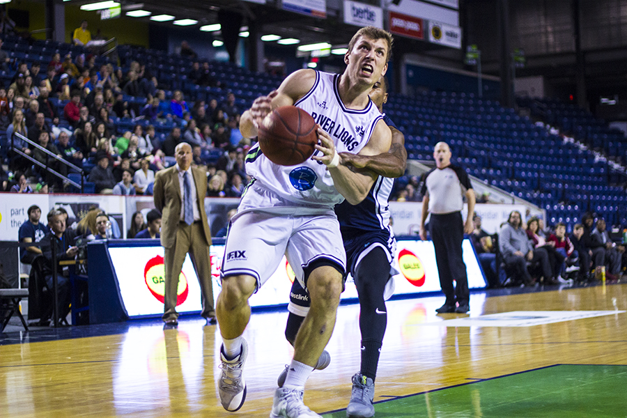 Adam Klie of the Niagara River Lions fights off contact while driving to the basket.   PHOTO BY ALEX   LUPUL