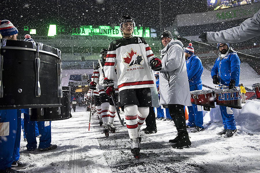 Team Canada defenceman Kale Clague walks  towards the ice surface during the 2018 IIHF World Junior Championship outdoor game.