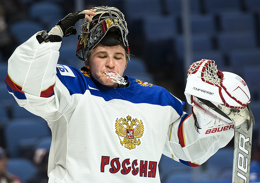 Russian goaltender Vladislav Sukhachyov sprays water from his mouth during a stoppage in play at the 2018 IIHF World Junior Championship in Buffalo, NY.