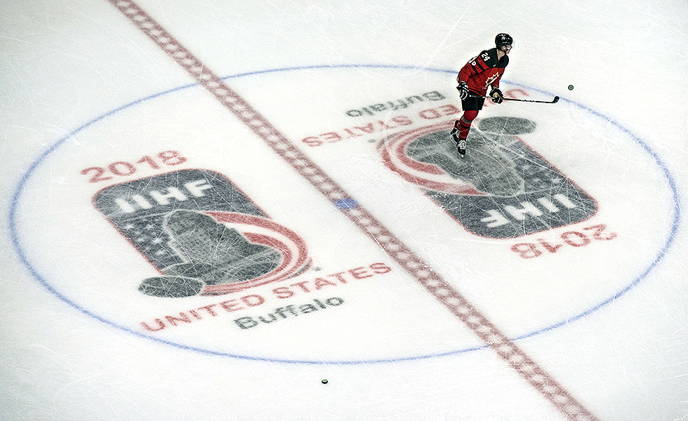 Team Canada forward Alex Formenton flips a puck into the air during pre-game warm ups at the 2018 IIHF World Junior Championship.