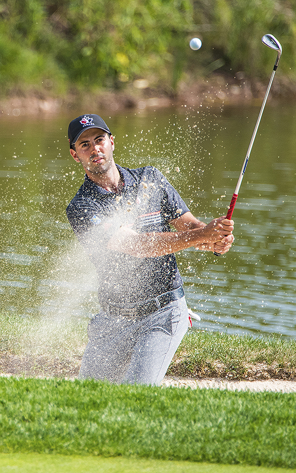 Canadian golfer Joey Savoie's shot from a sand trap lands onto the fourth green during the RBC Canadian Open at Glen Abbey Golf Club.