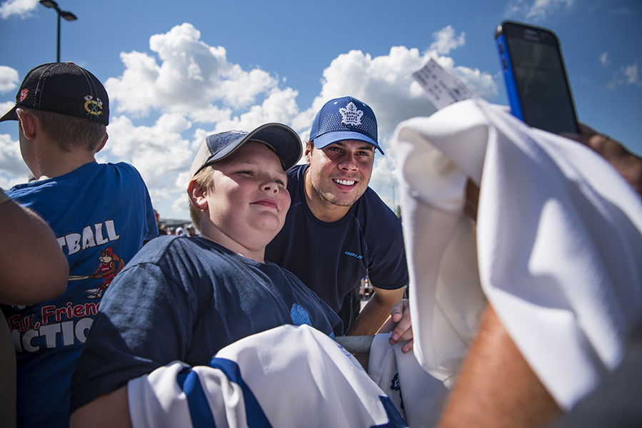 Toronto Maple Leafs centre Auston Matthews poses for a photo with a fan during the team's 2018 training camp in Niagara Falls.