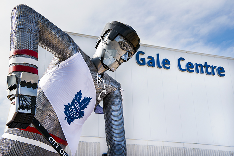 """A statue standing outside of Niagara Falls' Gale centre, entitled """"Blades of Steel,"""" is outfitted with a Toronto Maple Leafs flag during the team's training camp."""