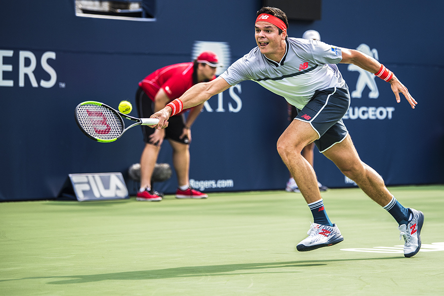 Canadian tennis player Milos Raonic runs down a cross-court shot at the 2018 Rogers Cup in Toronto, ON.