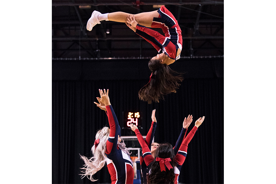 Brock University's Cheer Team energized the crowd during halftime at the Meridian Centre.