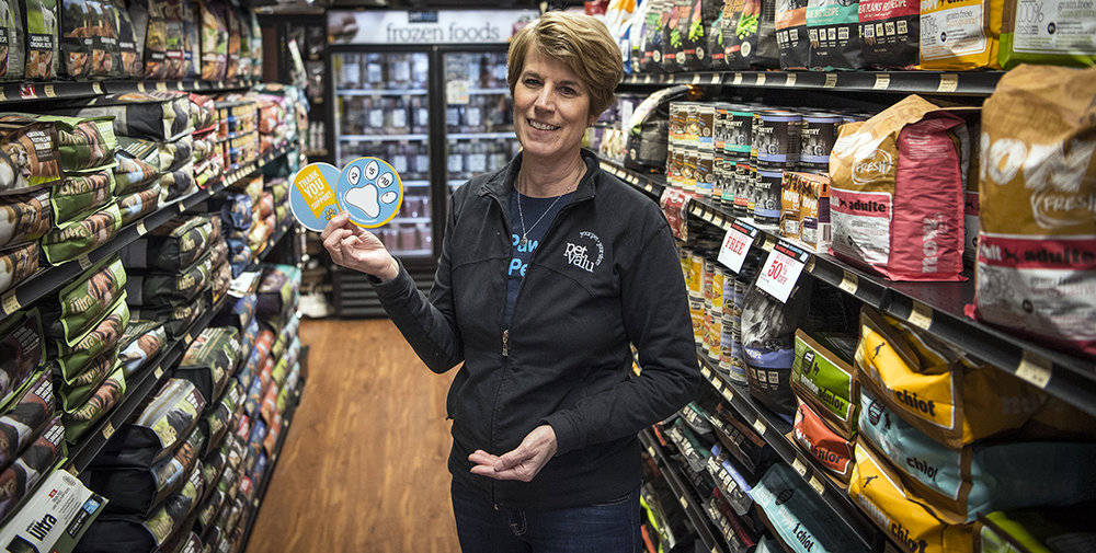 "Brigit Cardin, owner/operator of Pet Valu Welland, is asking customers to ""buy a paw, help a pet"" this month, with proceeds going towards two local charities. Photo by Alex Lupul"