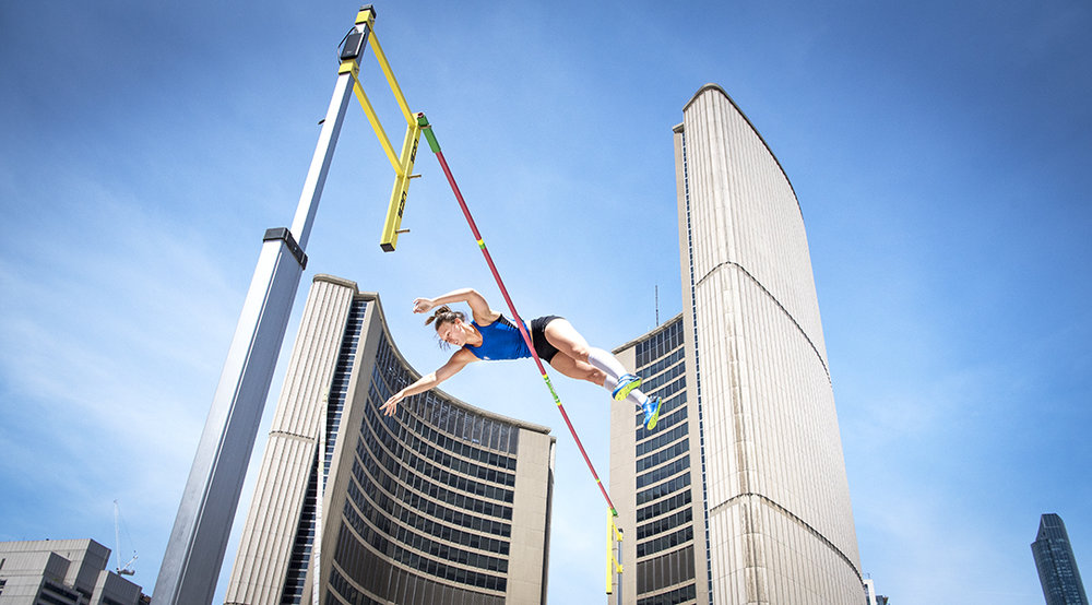 Carolina Carmichael reaches new heights outside of Toronto City Hall while competing in Athletics Canada's Track & Field Takeover at Nathan Phillips Square.