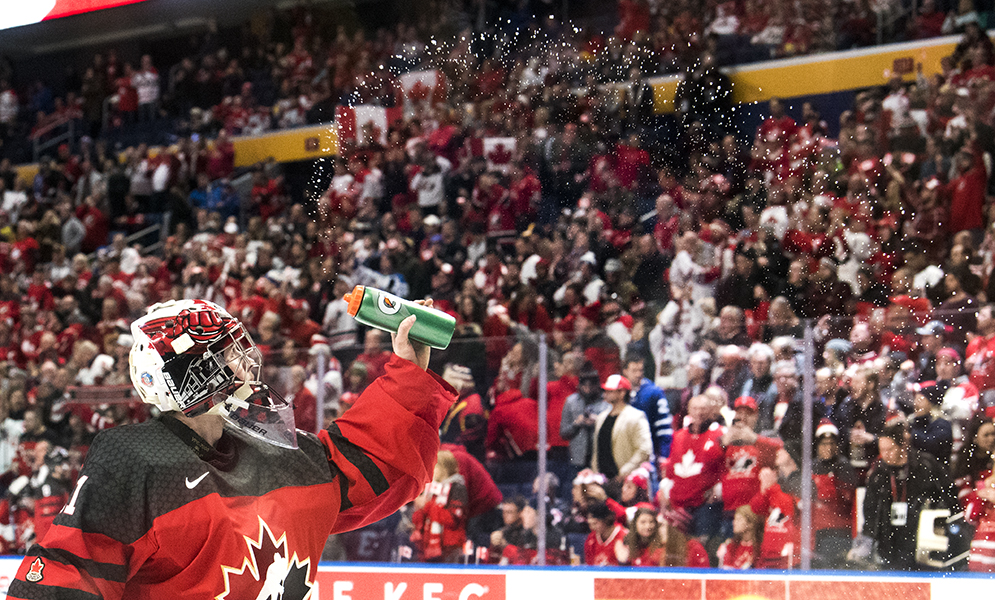 Team Canada goaltender Carter Hart sprays water from his water bottle during the 2018 IIHF World Junior Championship in Buffalo, NY.