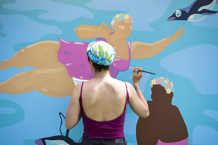 Muralist Tisha Myles blends in with her work at Field Trip Music Festival in Toronto, ON, on June 2.