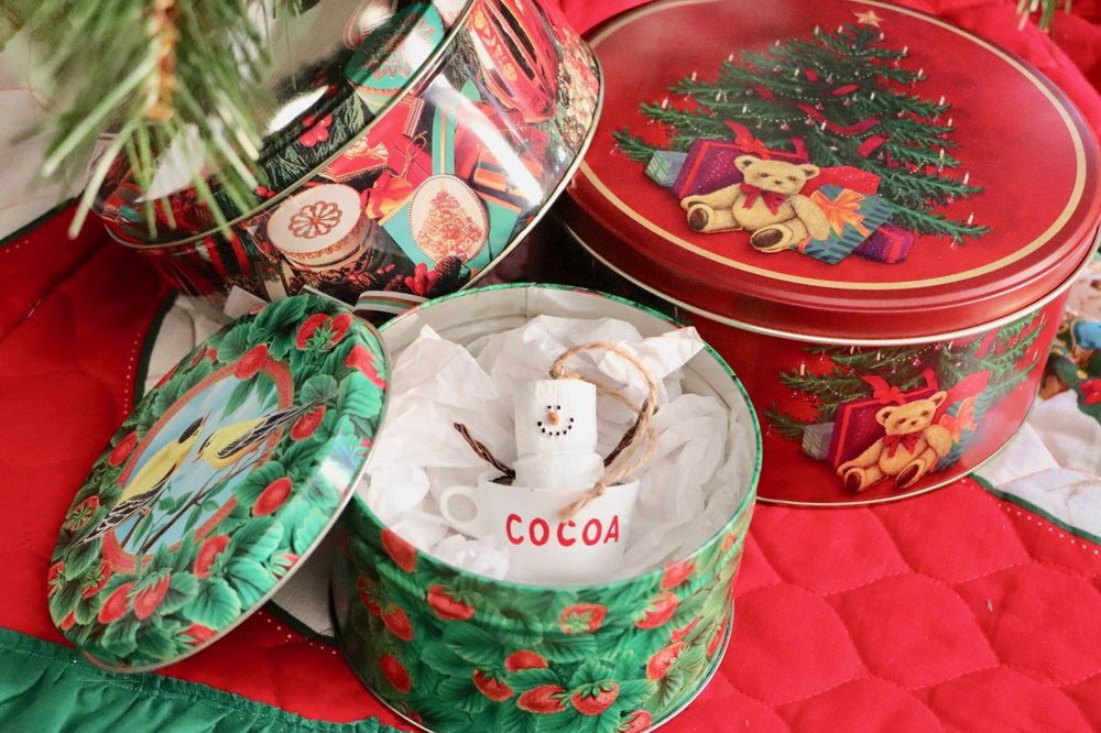 Another cute little cookie tin that I use for ornaments - it doesn't have to be Christmas themed! I love this little tin with strawberries & birds on it for ornament storage, plus it's still red & green right? Perfect!  Photo by: Lighter Side Interiors