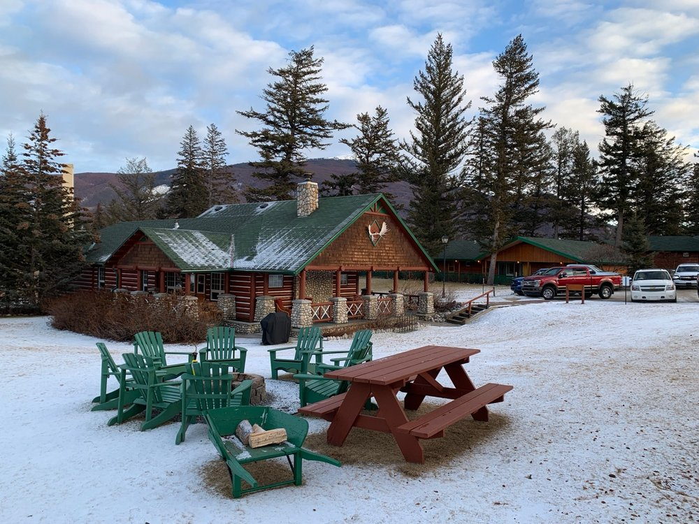 Fire pit and picnic table on the grounds of the Fairmont Jasper Park Lodge! Photo by: Lighter Side Interiors