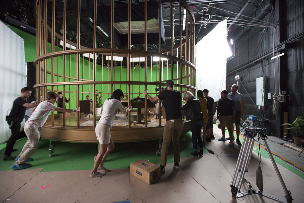 Cage rotation on the green screen stage by the crew