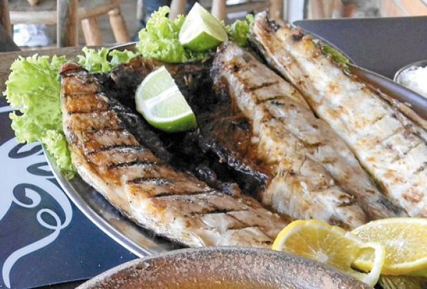 Tainha feira na grelha: a melhor forma de conservar o sabor do peixe. Imagem: O Tempo.